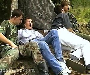 Lewd military guys seduce cute civil boys outdoors