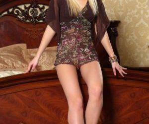 Sexy blonde teen Roxy G spreads..