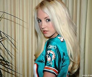 Cute girl in a football jersey..