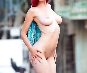 Slender redhead nude outdoors and..