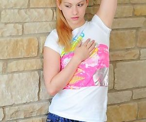 Adorable teen blonde pulls jeans..