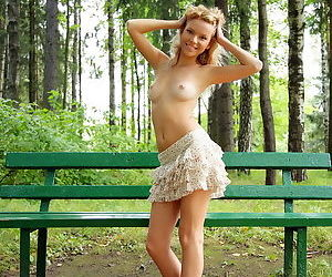 Shaved tight blonde girl outdoors..