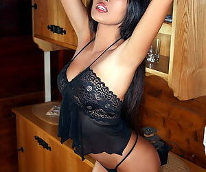 Young Asian in black lace lingerie gets naked to show her fresh pussy