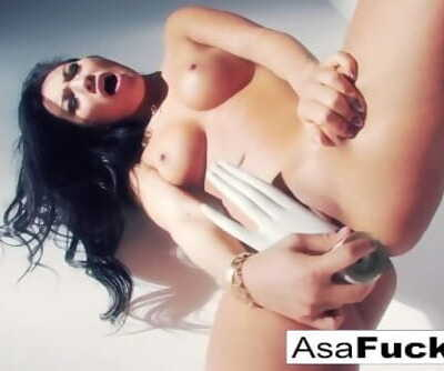Asa Akira uses a fake palm to please her pussy