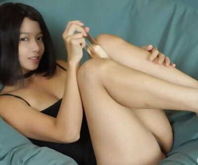 Asian Woman Masturbates With A Huge Glass Dildo and Gets Fountain Squirt