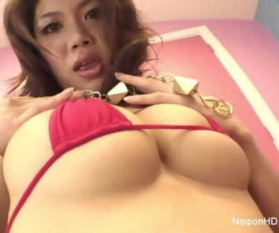 Naturally big-titted Asian cutie thumbs and fucks her pussy