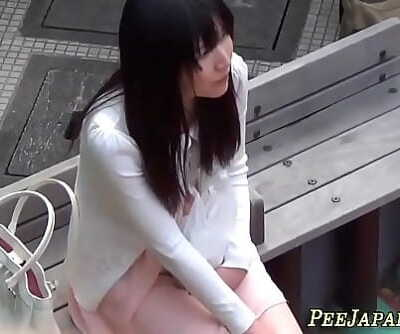 Asian scum peeing in her panties 10 min
