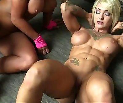 Dani Andrews and Megan Avalon Dame Muscle Lesbians 2 min HD