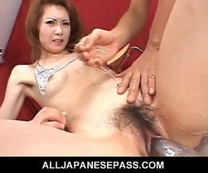 Rika Sakurai is in a silver bikini