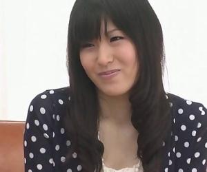 Nozomi Koizumi peels off naked and gives an asian oral..