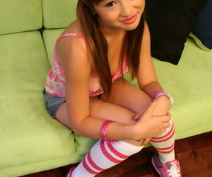 Young Asian babe Tia Tanaka shows her trimmed vagina and..