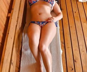 Buxom Asian model Tigerr Benson strutting non naked in..