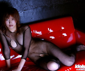 Filthy asian babe in tights suit revealing her small tits..