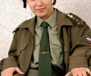 Korean inexperienced Elena undressing off military uniform..