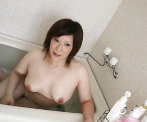 Naughty asian MILF Kimiko Ogata showing her doable forms..