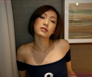 Diminutive Japanese woman Iino Nene gives a blowjob on her..