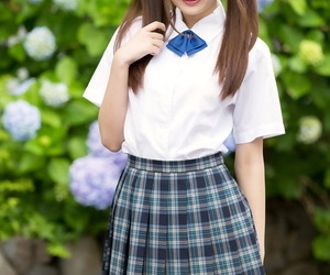 Cutie Japanese schoolgirl in pigtails shows bare ass in no..