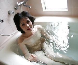 Asian mummy Michiyo Fukumoto gushes off her tiny tits..