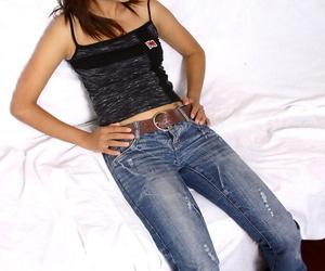 Amateur Asian honey in jeans revealing big innate hooters..