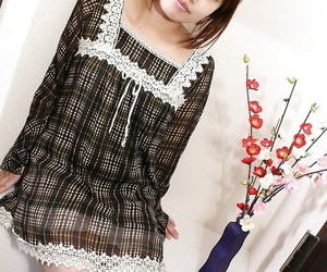 Asian MILF Rika Okabe unclothing and displaying her photos..