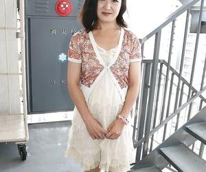 Asian Mummy Chiyo Yamabe lowering her undies and unveiling..
