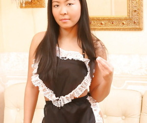 Oriental maid Courtney leisurely stripping off her..
