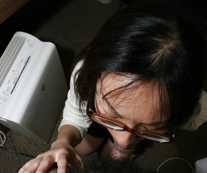 Clothed asian Mummy in glasses gives head and gets her fur..