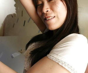 Timid asian chick peels off down and gushes her hairy poon..