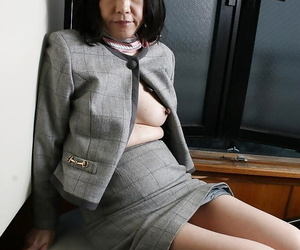 Saucy asian granny Makiko Nakane toying her unshaven pussy