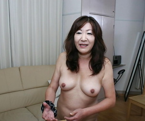 Horny asian granny with puffy tits and S/M coochie taking..