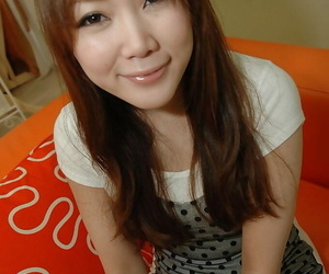 Asian teenage Tomoe Nitta undressing and revealing her S/M..