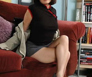 Glasses wearing Asian inexperienced spreading gams to..