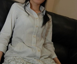 Asian woman Satomi Fujiki gets naked and likes cunt toying..
