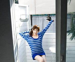 Naughty asian coed Rin Sakuragi revealing her tiny perky..