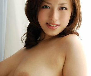 Adorable asian coed in undergarments showcasing her..