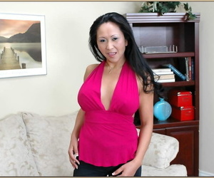 Asian Mummy Kitty Langdon unveiling sexy melons and..