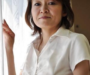 Shy mature asian girl Takako Kumagaya undressing and..