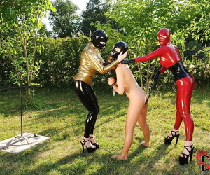 BDSM dommes in spandex suits have some fun with their..