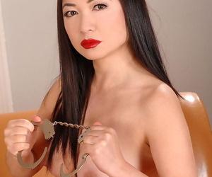 Asian stunner in latex Midori Tanaka is pleasuring a dick..