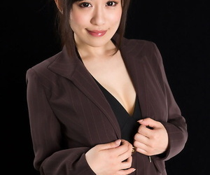 Japanese woman in suit leisurely takes off to the toes to..