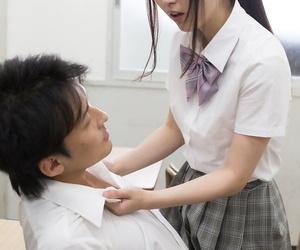 Japanese schoolgirl jerks off her teachers dick with her..