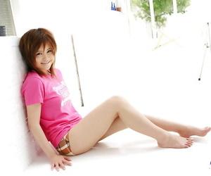 Seductive asian coed Hitomi Yoshino exposing her small..