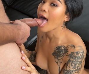 Inked Asian woman Honey Gold blows a cock in the naked