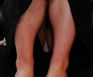 Asian housewife Aiko Kurita stretching her fur covered..