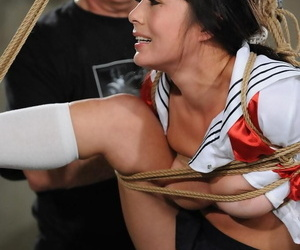 Asian dame is suspended by ropes while enduring agonizing..
