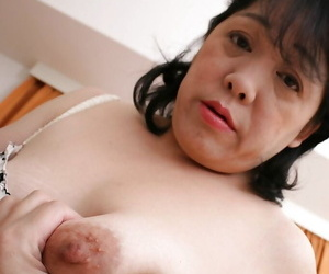Ball licking action from a black-haired Asian mature Eiko..