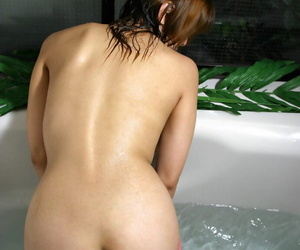 Alluring asian coed with tiny tits taking bathtub in her..