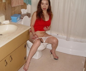 Dirty-minded thai slut peeing and wipping up her hairless..