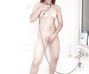 Bangable asian stunner taking shower and rubbing her soapy..