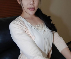 Asian brunette babe Ruriko Furuse strips her stockings and..
